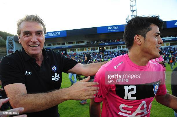 Chilean Huachipato team coach Jorge Pelliser and goalkeeper Nery Veloso celebrate after defeating Union Espanola in National Championship 2012 second...
