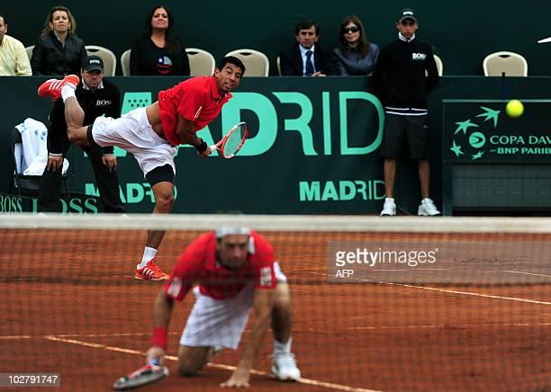 Chilean Jorge Aguilar serves next to teammate Nicolas Massu in their Davis Cup quarterfinal doubles match against Jan Hajec and Lukas Dlouhy of Czech...