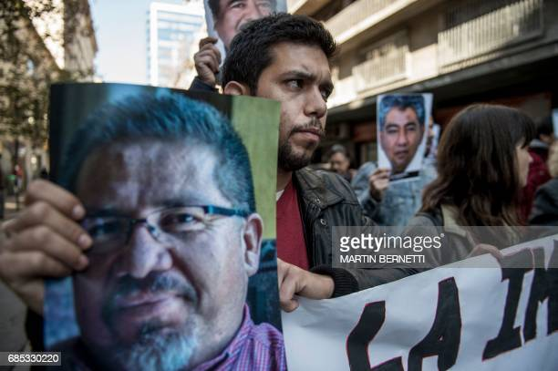 Chilean journalists hold signs condemning violence against journalists while protesting the recent murder of Mexican journalist Javier Valdez in...
