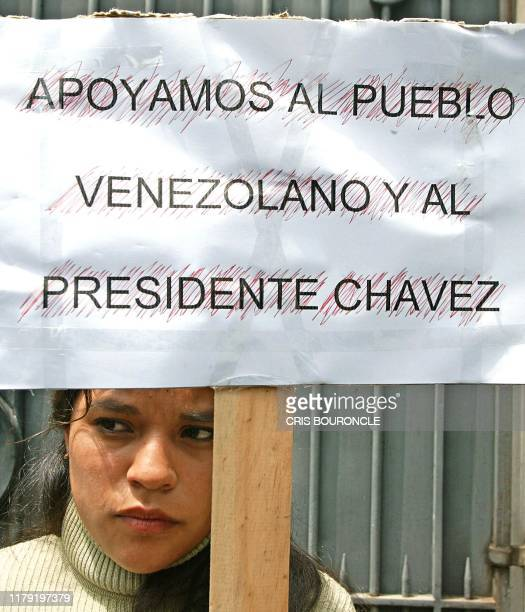 A chilean member of the Bolivarian Committee of solidarity demonstrates in favor of Venezuelan President Hugo Chavez in front of the Venezuelan...