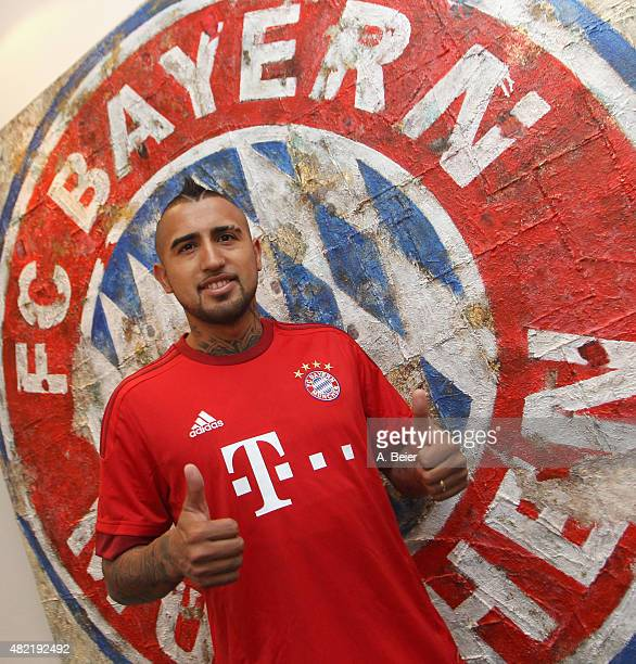 Chilean midfielder Arturo Vidal poses for photographer after he signed his contract with FC Bayern Munich on July 28 2015 in Munich Germany