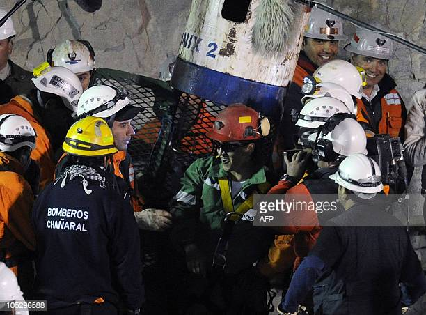 Chilean miner Ariel Ticona exits the Fenix 2 capsule after being brought to the surface from the San Jose mine near Copiapo Chile on October 13 2010...