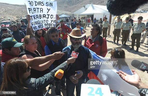 Chilean miner Jorge Galleguillos one of the 33 recently rescued from San Jose mine answers questions from the press as he arrives at the San Jose...