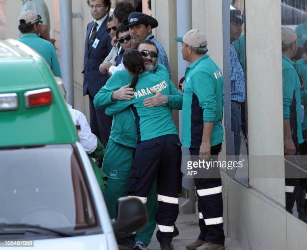 Chilean miner Jorge Galleguillos one of the 33 recently rescued is embraced by paramedic personal as leaves the hospital in Copiapo Chile on October...