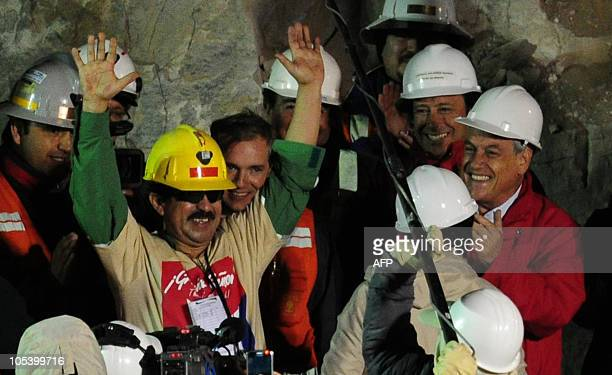 Chilean miner Juan Illanes celebrates after comes out of the Fenix capsule after being brought to the surface on October 13, 2010 following a 10-week...