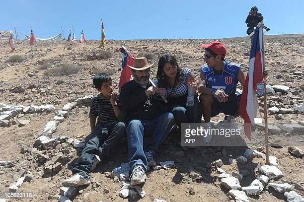 Chilean miners Jorge Galleguillos and Jimmy Sanchez two of the 33 recently rescued from San Jose mine are seen at the San Jose mine for a mass near...