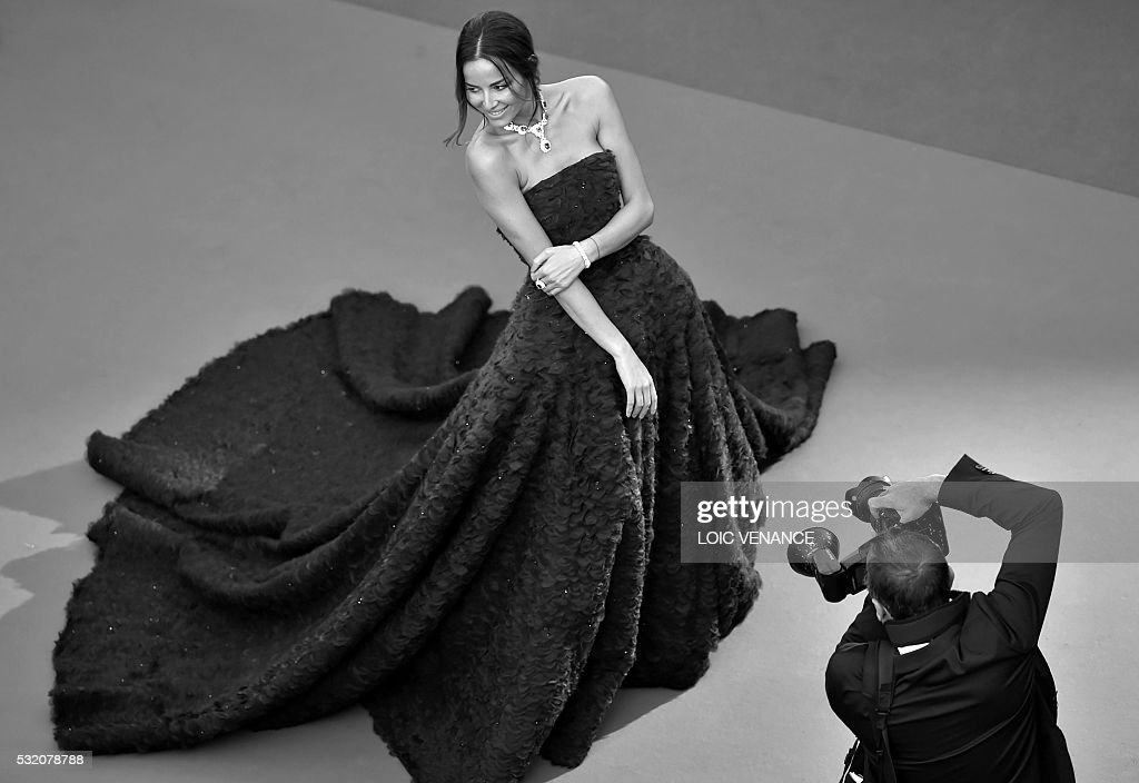 Chilean model and actress Carolina Parsons poses as she arrives on May 17, 2016 for the screening of the film 'Julieta' at the 69th Cannes Film Festival in Cannes, southern France. / AFP / LOIC
