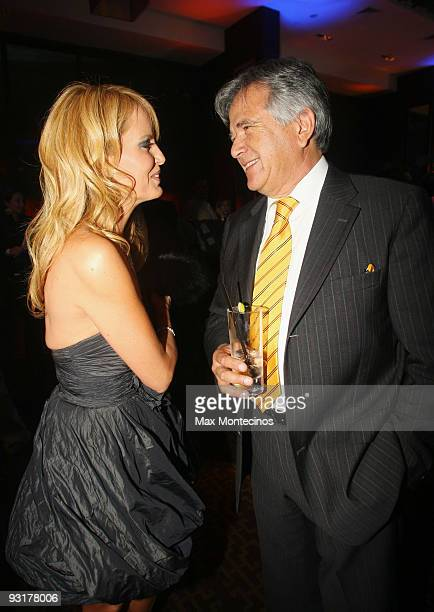 Chilean model Cecilia Bolocco talks to Chilean businessman Carlos Cardoen during the inaguration of W Hotel Santiago on November 17 2009 in Santiago...
