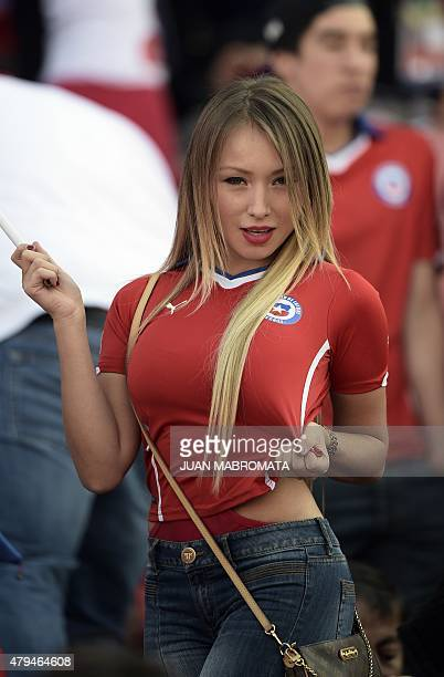 Chilean model Daniella Chavez cheers for her team before the start of the 2015 Copa America football championship final Argentina vs Chile in...