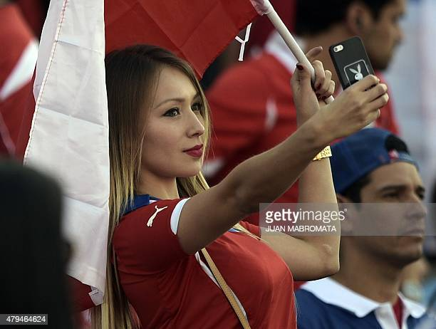 Chilean model Daniella Chavez takes a selfie before the start of the 2015 Copa America football championship final Argentina vs Chile in Santiago...