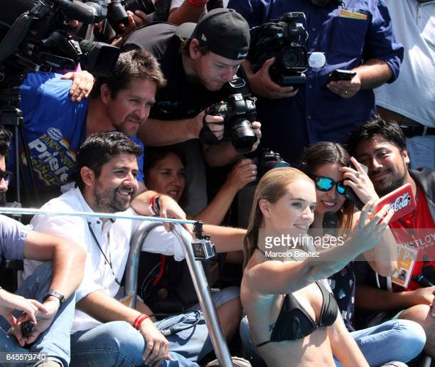 Chilean model Kika Silva takes a selfie during Queen of 58th Viña del Mar International Song Festival Photocall at the pool of O'Higgins Hotel on...