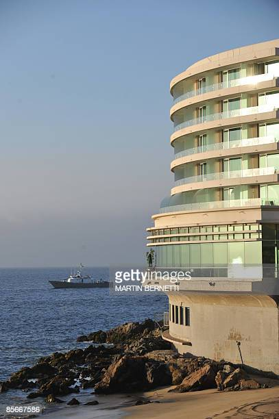 A Chilean Navy vessel patrols the coastline in front of the hotel where the Progressive Governance Leaders' Summit will be held in Vina del Mar 120...