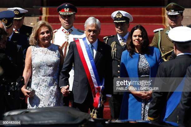TOPSHOT Chilean new President Sebastian Pinera and his wife Cecilia Morel leave the Congress in Valparaiso Chile after his inauguration ceremony on...