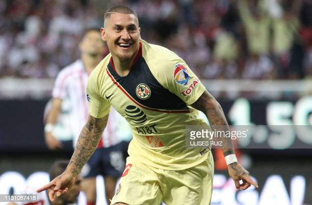 Chilean Nicolas Castillo of America celebrates after scoring against Guadalajara during their Mexican Clausura football tournament match at the Akron...