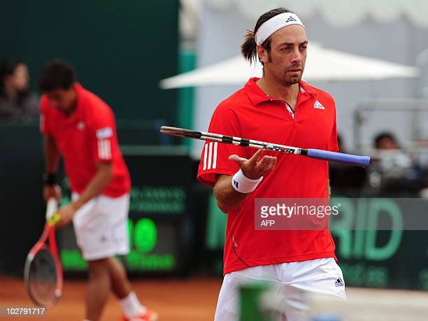 Chilean Nicolas Massu and Jorge Aguilar participate in their Davis Cup quarterfinal doubles match against Jan Hajec and Lukas Dlouhy of Czech...