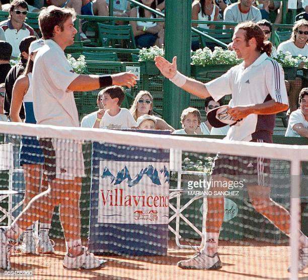 Chilean Nicolas Massu shakes hands with argentinian Agustin Calleri after their ATP tournament match at the Buenos Aires Lawn Tennis Club 24 February...