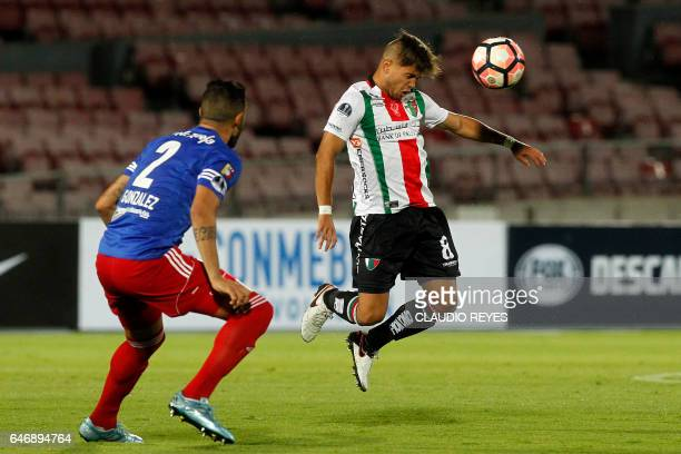 Chilean Palestino's footballer Franco Mazurek vies for the ball with Cristian Gonzalez of Venezuelan Atletico Venezuela during their Copa...