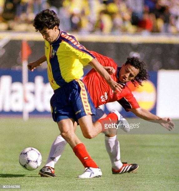 Chilean player Fabian Estay fights for a ball with Ecuadorian player Ivan Caviedes in Quito Ecuador 08 October 2000 Ecuador defeated Chile 10 in...