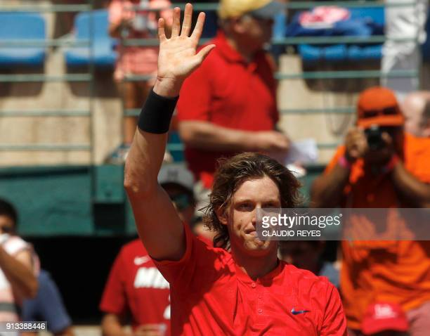 Chilean player Nicolas Jarry waves after defeating Ecuadorean player Ivan Endara at the end of their Davis Cup singles tennis match at the National...