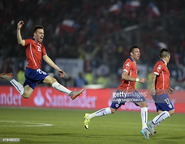 Chilean players Angelo Henriquez Mauricio Isla and Gary Medel celebrate after beating Argentina in a penalty shootout in the 2015 Copa America...