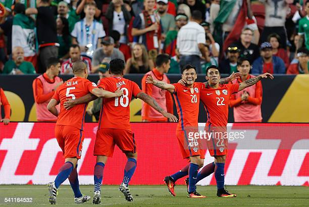 Chilean players celebrate after a Copa America Centenario quarterfinal football match against Mexico in Santa Clara California United States on June...