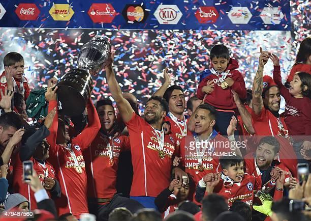 Chilean players celebrate after winning the 2015 Copa America football championship final against Argentina, in Santiago, Chile, on July 4, 2015....