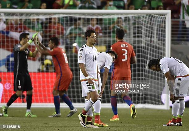 Chilean players celebrate as Mexican players react in dejection after the Copa America Centenario quarterfinal football match in Santa Clara...