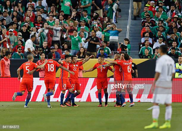Chilean players celebrate during a Copa America Centenario quarterfinal football match against Mexico in Santa Clara California United States on June...