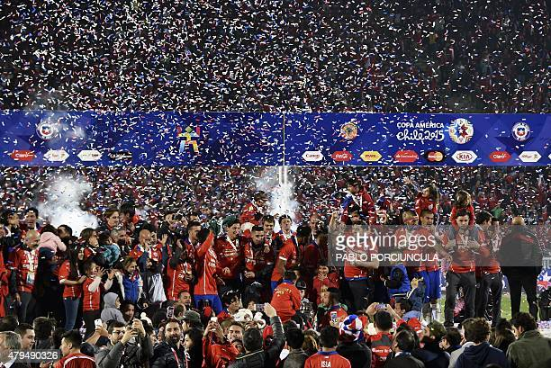 Chilean players celebrate with the trophy of the 2015 Copa America football championship in Santiago Chile on July 4 2015 AFP PHOTO / PABLO...