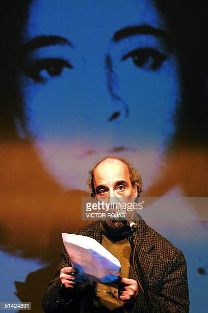 Chilean poet Raul Zurita reads a text during a commemorative act that marks the Day of the Detained Disappeared in Santiago Chile 30 August 2002The...