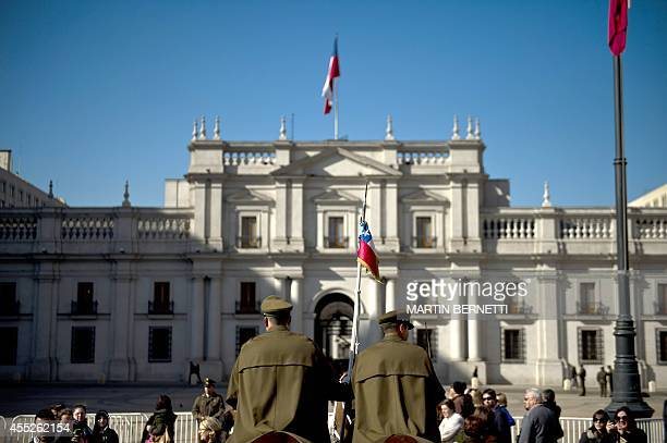 Chilean police stand guard outside La Moneda presidential palace in Santiago on September 11 during the commemoration of the 41st anniversary of the...