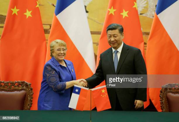 Chilean President Michelle Bachelet and Chinese President Xi Jinping attend a signing ceremony ahead of the Belt and Road Forum in Beijing China May...