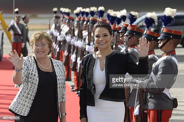 Chilean President Michelle Bachelet and Guatemalan VicePresident Roxana Baldetti wave upon Bachelet's arrival at the Guatemalan Air Force base in...