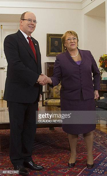 Chilean President Michelle Bachelet and Prince Albert II of Monaco shake hands during a meeting at La Moneda presidential palace in Santiago on July...