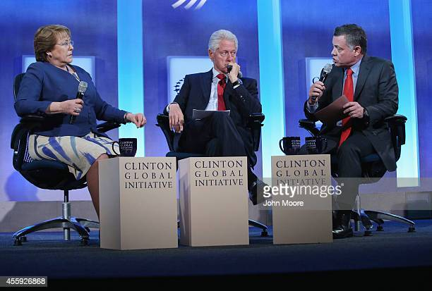 Chilean President Michelle Bachelet former US President Bill Clinton and King Abdullah II ibn Al Husseib of Jordan take part in a panel discussion at...