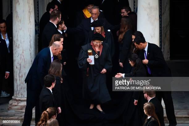 TOPSHOT Chilean President Michelle Bachelet leaves followed by Evora's University Dean Ana Costa Freitas and Portuguese President Marcelo Rebelo de...
