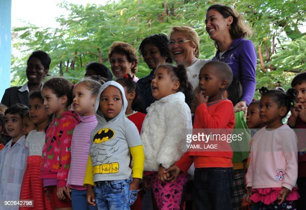 Chilean President Michelle Bachelet poses for pictures with children and teachers at the Pedagogical School Salvador Allende where she arrived to...