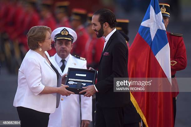 Chilean President Michelle Bachelet receives the keys to the city of San Salvador from Mayor Nayib Bukele upon her arrival at the Monsignor Oscar...