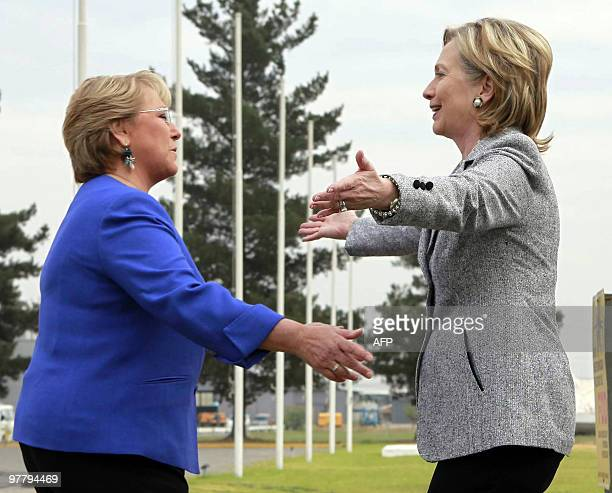 Chilean President Michelle Bachelet receives US Secretary of State Hillary Rodham Clinton at the airport in Santiago Chile on March 2 2010 AFP...
