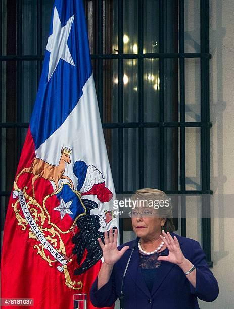 Chilean President Michelle Bachelet speaks during a press conference at La Moneda presidential palace in Santiago on March 12 2014 Bachelet moved...