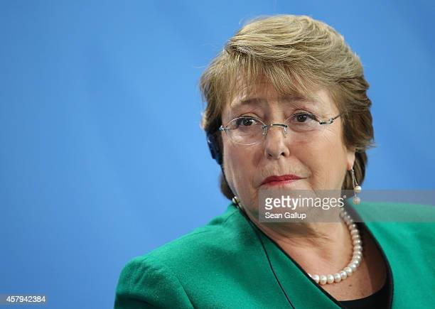 Chilean President Michelle Bachelet speaks to the media with German Chancellor Angela Merkel following talks at the Chancellery on October 27 2014 in...