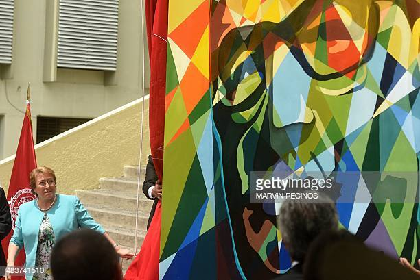 Chilean President Michelle Bachelet unveils a painting with an image of former Chilean president Salvador Allende at the University of El Salvador in...