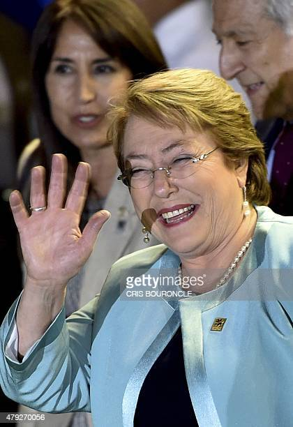 Chilean President Michelle Bachelet waves during the Business Forum within the X Pacific Alliance Summit in Paracas 250 km south of Lima on July 2...