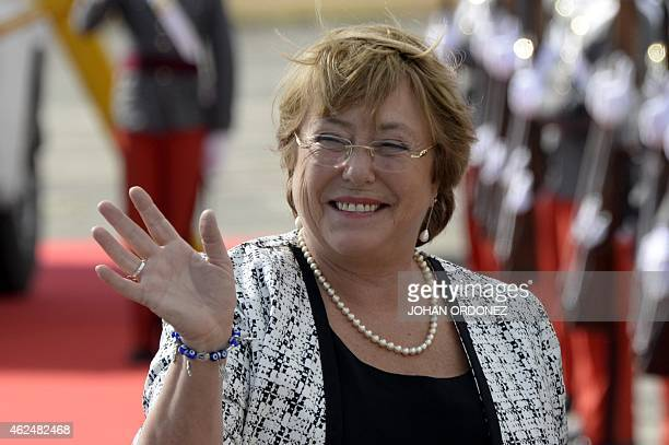 Chilean President Michelle Bachelet waves upon her arrival at the Guatemalan Air Force base in Guatemala City on January 29 2015 AFP PHOTO Johan...