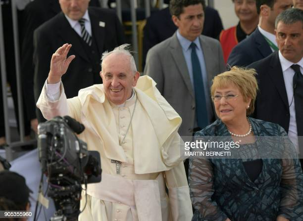 Chilean President Michelle Bachelet welcomes Pope Francis to Chile at the Arturo Merino Benitez airport in Santiago on January 15 2018 / AFP PHOTO /...