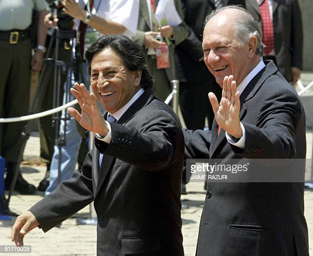 Chilean President Ricardo Lagos and Peruvian President Alejandro Toledo wave upon their arrival at the first session of the APEC leaders' Summit, 20...