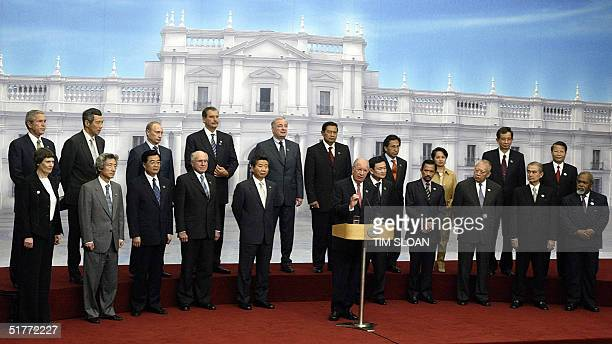 Chilean President Ricardo Lagos delivers a speech as other leaders of the AsiaPacific Economic Cooperation look on during the summit's closing...