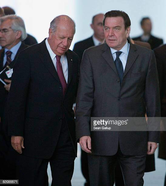 Chilean President Ricardo Lagos Escobar and German Chancellor Gerhard Schroeder arrive for a news conference at the Chancellery January 24 2005 in...