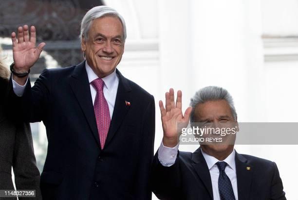 Chilean President Sebastian Pinera and Ecuador's President Lenin Moreno wave at the press during the welcoming ceremony at La Moneda Presidential...