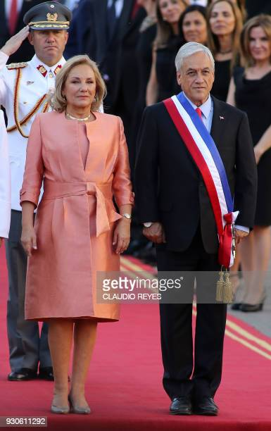 Chilean President Sebastian Pinera and his wife Cecilia Morel stand upon arrival at La Moneda presidential palace in Santiago after the inauguration...